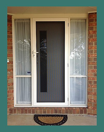 INVISI-GARD security screen door with glass side panels